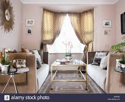 Modern Patterned Rugs by Patterned Curtains On Window In Modern Beige Living Room With