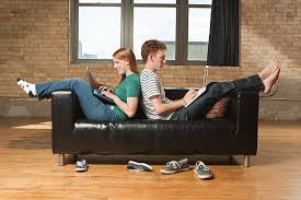 young man laptop couch pictures images and stock photos istock