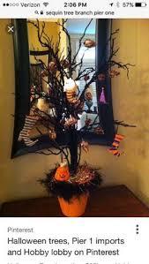 black metal ornament tree from pier 1 popcorn balls to it