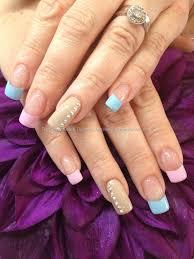 pink and blue polish with swarovski crystals nails