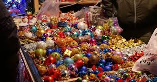 people buying christmas balls at a christmas market christmas