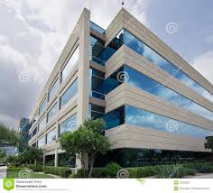 symbol of success modern glass office building stock photo