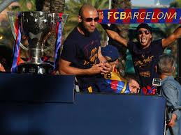barcelona celebrate la liga win with procession on open top