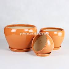 orange glazed ceramic flower pot orange glazed ceramic flower pot