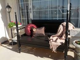 exterior rustic wood porch bench with arm and back rest placed on