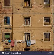 traditional venetian rendered building with window shutters stock