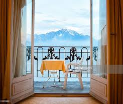 alpine view with balcony and open french doors stock photo getty
