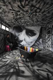 graffitied building walls to gallery walls scene360 indoor wall mural of woman by david walker