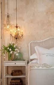 chandelier night stand l i d never think to put 2 small unmatching chandeliers above a