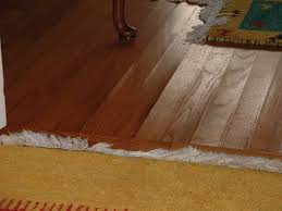 Warped Laminate Flooring How To Fix Buckling Hardwood Floors Titandish Decoration