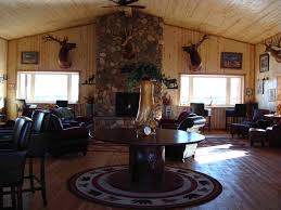 striking lodge with wood wall treatment also leather furnishings