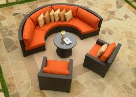 Rattan Curved Sofa by Patio 38 Outdoor Dining Table Fire Pit With Yellow Cushion