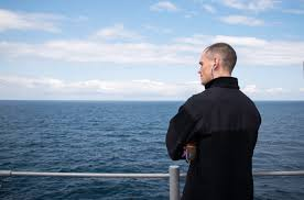 u s catholic navy chaplain offers on board mass and prayers for