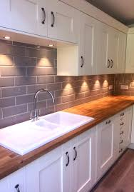 our edge grigio tiles look lovely in a cream kitchen with wooden