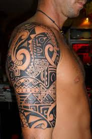 arinenal tribal tattoos on shoulder and chest
