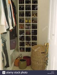 close up of large walk in wardrobe with sisal storage baskets and