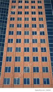skyscraper exteriors windows of a terracotta colored building