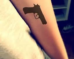 gun tattoo u2013 small gun design on arm tattooshunter com