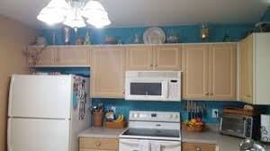 how to paint particle board cabinets painting particle board cabinets in mobile home hometalk