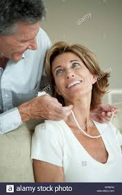 woman with necklace images Mature man giving woman a pearl necklace stock photo 48408857 alamy jpg