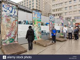 berlin wall sections street scene with tourists reading information by sections of the
