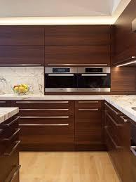 wood kitchen furniture walnut wood kitchen cupboards sleek handles inset sink in white
