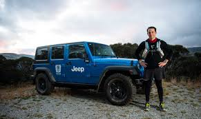 jeep mountain climbing man vs jeep wrangler