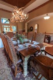 dining room sets michigan cast aluminum dining room set has images of bears fish elk or