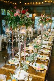 tall floral centerpieces white and yellow flowers classically