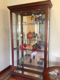 corner curio cabinets for sale furniture pulaski credenza fireplace tv stand big lots curio