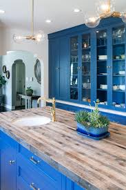 photos hgtv contemporary white kitchen featuring blue cabinets and photos hgtv contemporary white kitchen featuring blue cabinets and island with butcher block top