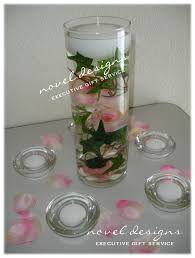 Floating Candle Centerpieces by Rose Water Floating Candle Centerpiece Lasvegas Event