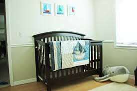 bedroom cozy white baby cache crib with blue mattress topper for