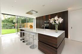 white and wood cabinets dark wood cabinets 9 inspirational kitchens that combine cabinetry