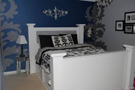 solid white wooden master bed alongside unique flower pattern wall