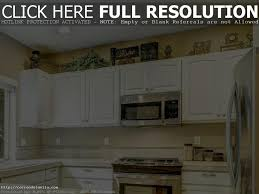 what do you put on top of kitchen cabinets martha stewart decorating above kitchen cabinets how to decorate top