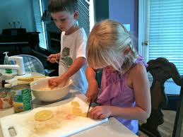 kids in the kitchen making fruit salad