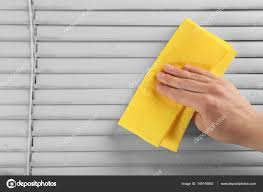 human hand cleaning dirty window blinds closeup u2014 stock photo