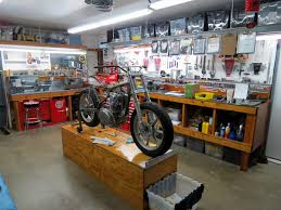 work under way in the workshop of richard pollock s mule richard pollock of mule motorcycles garage workshop