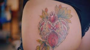 18 shocks tattoo fixers with tattoo on her bum of a cartoon