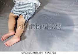 peeing the bed child pee on mattresslittle girl feet stock photo 617597366