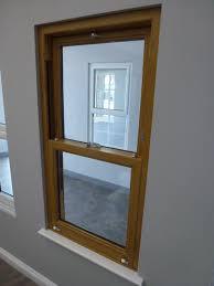 oak finished upvc vertical sliding sash window styles u0026 colours