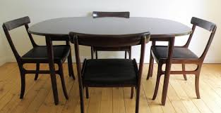 table satiating round table that expands to oval suitable round