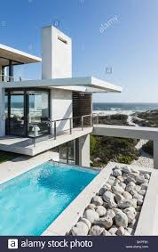 lap pool and balcony of modern house overlooking ocean stock photo