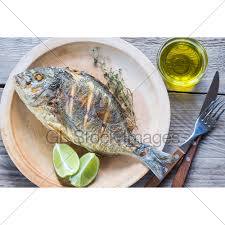 dorade cuisine grilled dorade royale fish on the plate gl stock images