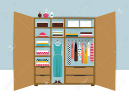 open wardrobe wooden closet with tidy clothes shirts sweaters