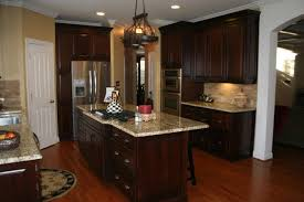 giallo fiorito granite with oak cabinets kraftmaid montclair cherry deason traditional kitchen