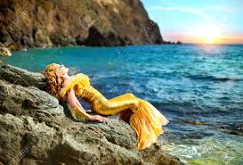 series young beautiful in the image of a mermaid stock photo
