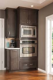 Kitchen Tall Cabinets This Tall Microwave And Oven Cabinet Follows The Current Trend To