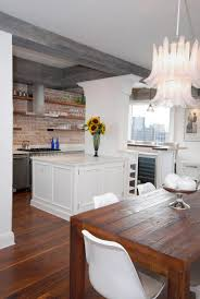 kitchen floating island floating shelves with red brick backsplash and kitchen hood also